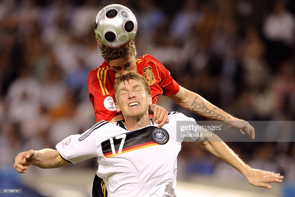 Spanish forward <a gi-track='captionPersonalityLinkClicked' href=/galleries/search?phrase=Fernando+Torres&family=editorial&specificpeople=194755 ng-click='$event.stopPropagation()'>Fernando Torres</a> (back) heads the ball ahead of German defender Per Mertesacker during the Euro 2008 championships final football match Germany vs. Spain on June 29, 2008 at Ernst-Happel stadium in Vienna, Austria.