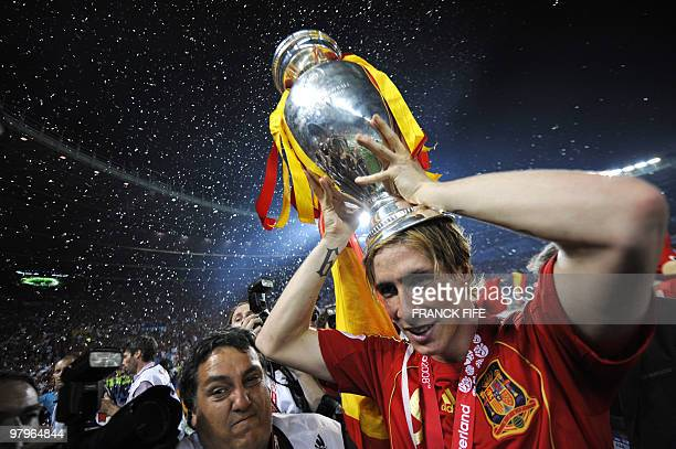 Spanish forward Fernando Torres holds the Euro 2008 championships trophye after winning the final football match against Germany on June 29 2008 at...