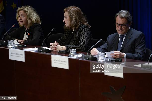 Spanish general attorney Consuelo Madrigal MartinezPereda speaks as Catalonia's regional government president and leader of the Catalan Democratic...