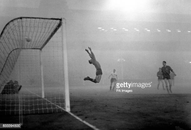 Spanish goalkeeper Carmelo Cedrun leaps arched back to save a high shot in the closing minutes of the match