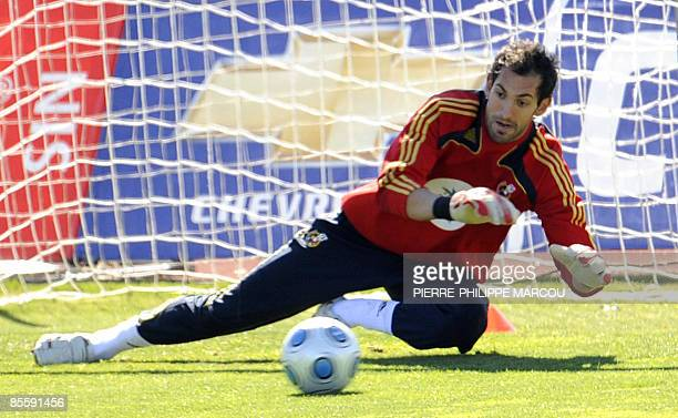 Spanish goalkeeper Diego Lopez stops a ball during a training session in Las Rozas on March 25 2009 Spain will play a FIFA World Cup South Africa...