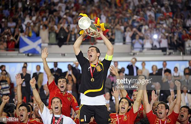 Spanish goalkeeper Iker Casillas holds the Euro 2008 championships trophy after Spain won the final football match over Germany on June 29 2008 at...