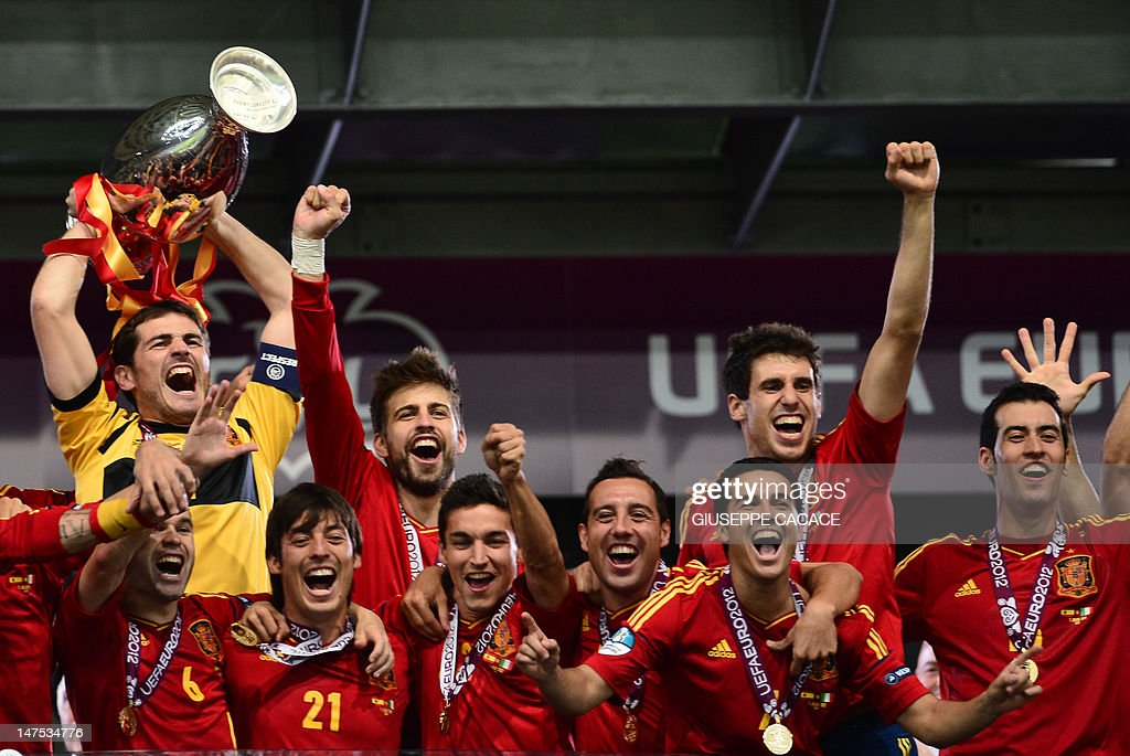 Spanish goalkeeper Iker Casillas holds the trophy as he celebrates with teammates after winning the Euro 2012 football championships final match Spain vs Italy on July 1, 2012 at the Olympic Stadium in Kiev. Spain won 4-0.
