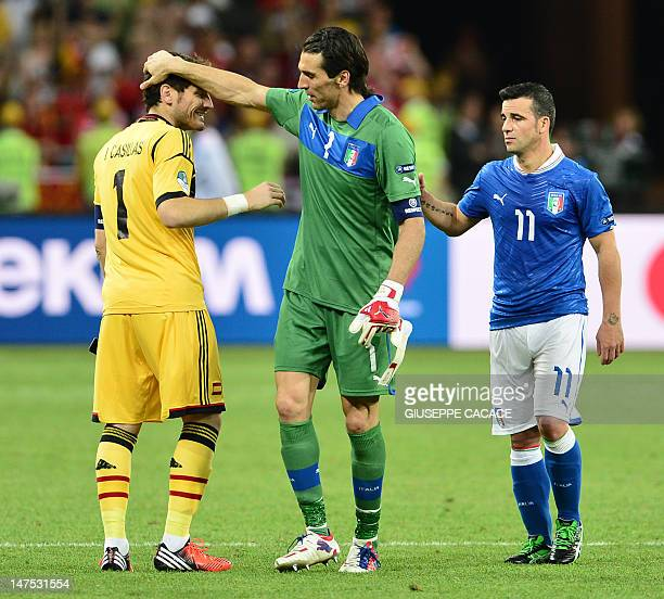 Spanish goalkeeper Iker Casillas is congratulated by Italian goalkeeper Gianluigi Buffon at the end of the Euro 2012 football championships final...