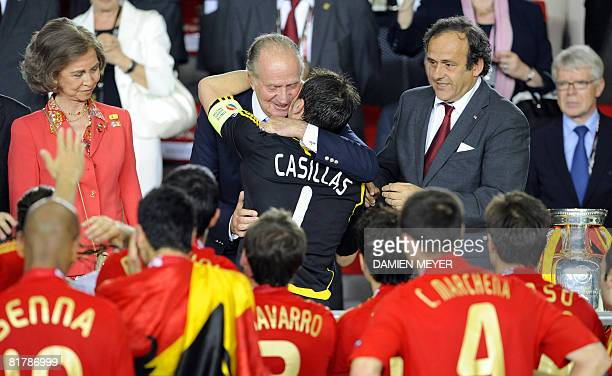 Spanish goalkeeper Iker Casillas is congratulated by King Juan Carlos of Spain surrounded by teammates Queen Sofia and UEFA President Michel Platini...
