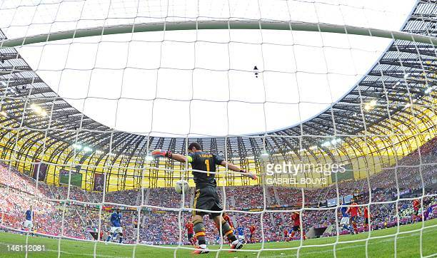 Spanish goalkeeper Iker Casillas makes a save during the Euro 2012 championships football match Spain vs Italy on June 10 2012 at the Gdansk Arena...