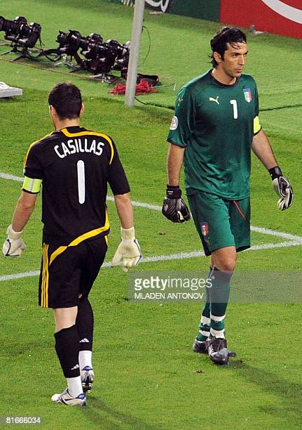 Spanish goalkeeper Iker Casillas walks by Italian goalkeeper Gianluigi Buffon during the penalty shoot out stage of their Euro 2008 Championships...