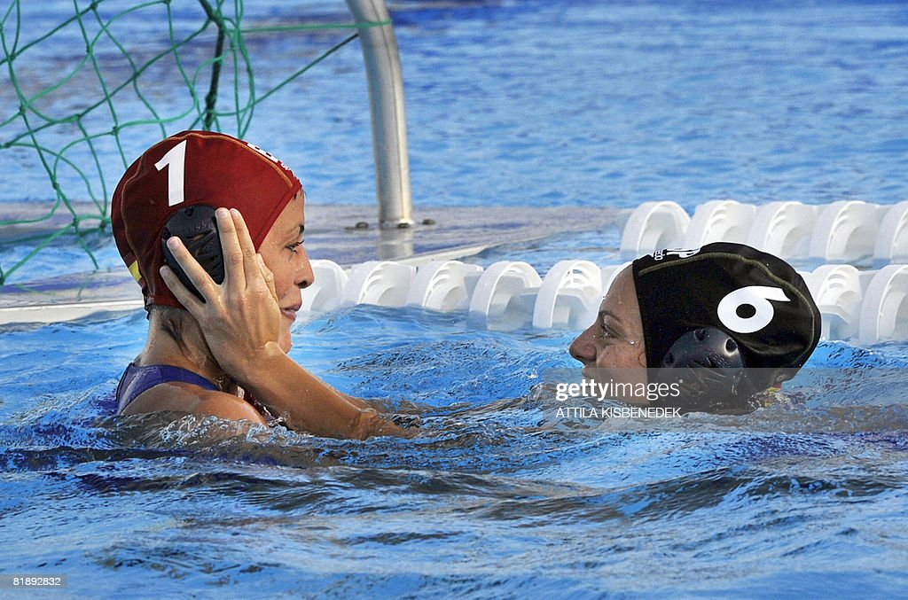 Spanish goalkeeper Patricia Del Soto celebrates with her teammate Jennifer Pareja their victory against Hungary in the aquatic center swimming pool...