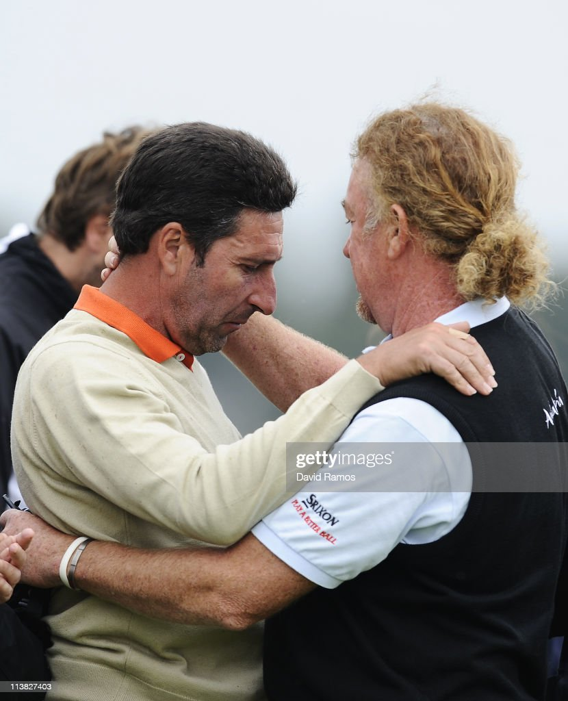 Spanish golf players Jose Maria Olazabal of Spain and Miguel Angel Jimenez after the minute silence held in memory of Seve Ballesteross during the...