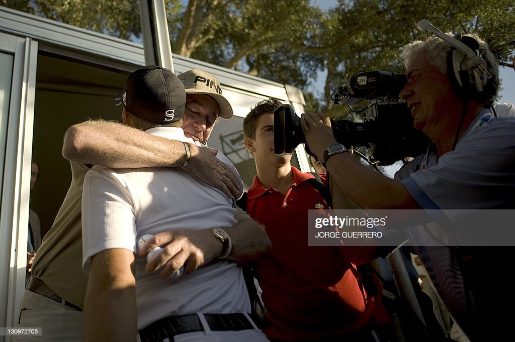 Spanish golfer Miguel Angel Jimenez (R) congratulates his compatriot Sergio Garcia (L) after he won the EPGA Andalucia golf Masters in Sotogrande on October 30, 2011. Garcia edged out Jimenez by one stroke after shooting a fourth round level par of 71 for a six under par total of 278.