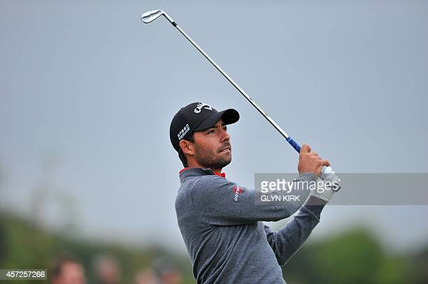 Spanish golfer Pablo Larrazabal watches his drive to the 14th green in his match against French golfer Victor Dubuisson during the first day of the...