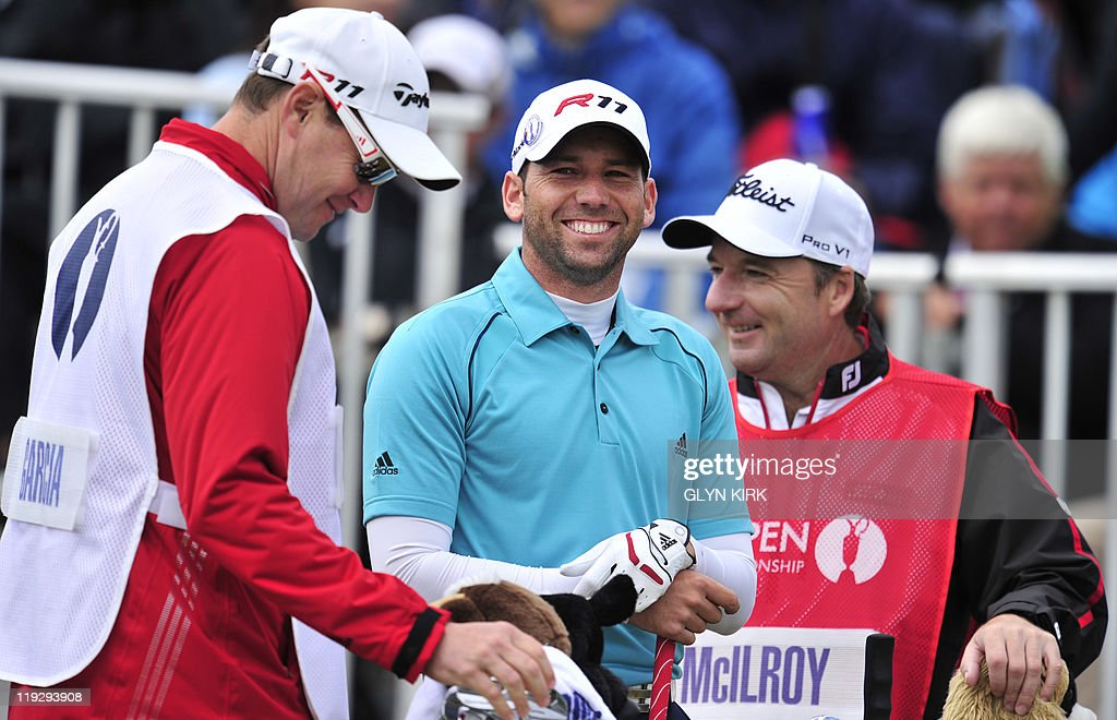 Spanish golfer Sergio Garcia (C) arrives on the 1st tee, on the final day of the 140th British Open Golf championship at Royal St George's in Sandwich, Kent, south east England, on July 17, 2011.