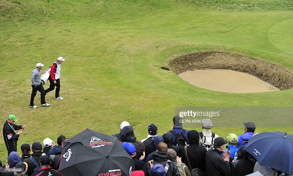 Spanish golfer Sergio Garcia arrives on the 6th green on the final day of the 140th British Open Golf championship at Royal St George's in Sandwich, Kent, south east England, on July 17, 2011. AFP PHOTO / GLYN KIRK