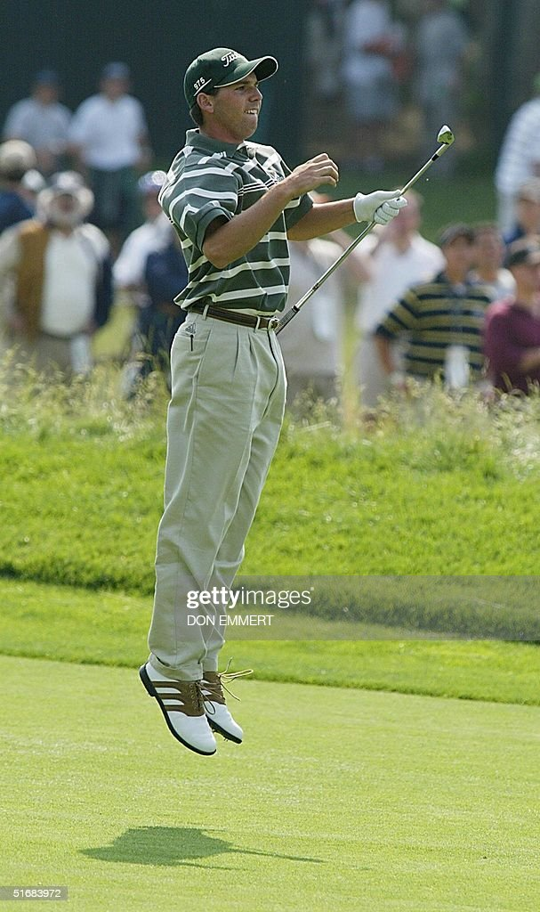 Spanish golfer Sergio Garcia jumps to see where his ball landed after his hit from the 4th fairway during the final round at the 102nd US Open...