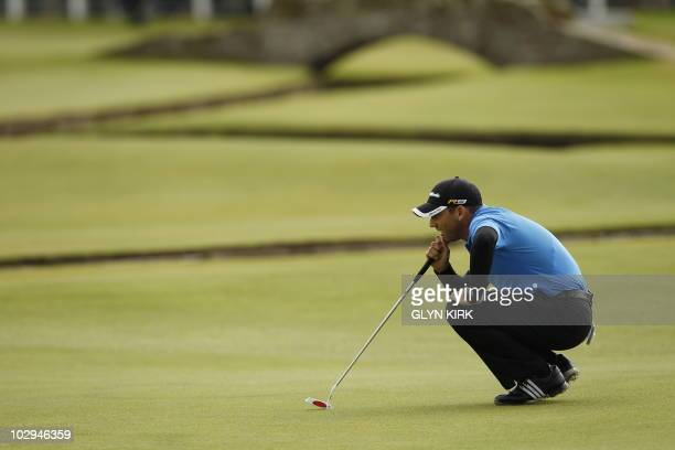 Spanish golfer Sergio Garcia lines up a putt on the 1st Green during his third round on day three of the British Open Golf Championship at St Andrews...