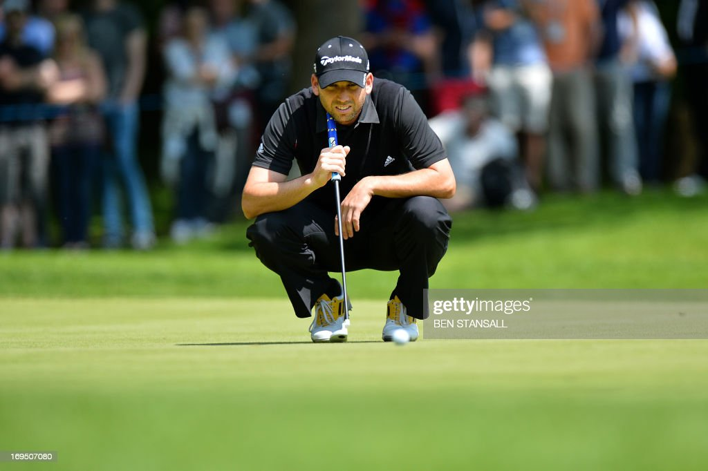 Spanish golfer Sergio Garcia lines up a putt on the 1st green during the final round of the BMW PGA Championship at Wentworth Golf Club in Surrey...