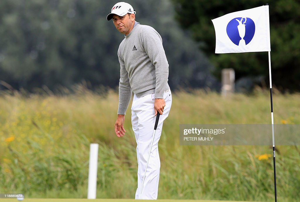 Spanish golfer Sergio Garcia lines up his putt on the 14th green during practice for the 140th British Open Golf championship at Royal St George's in Sandwich, Kent, south east England, on July 12, 2011. AFP PHOTO / PETER MUHLY