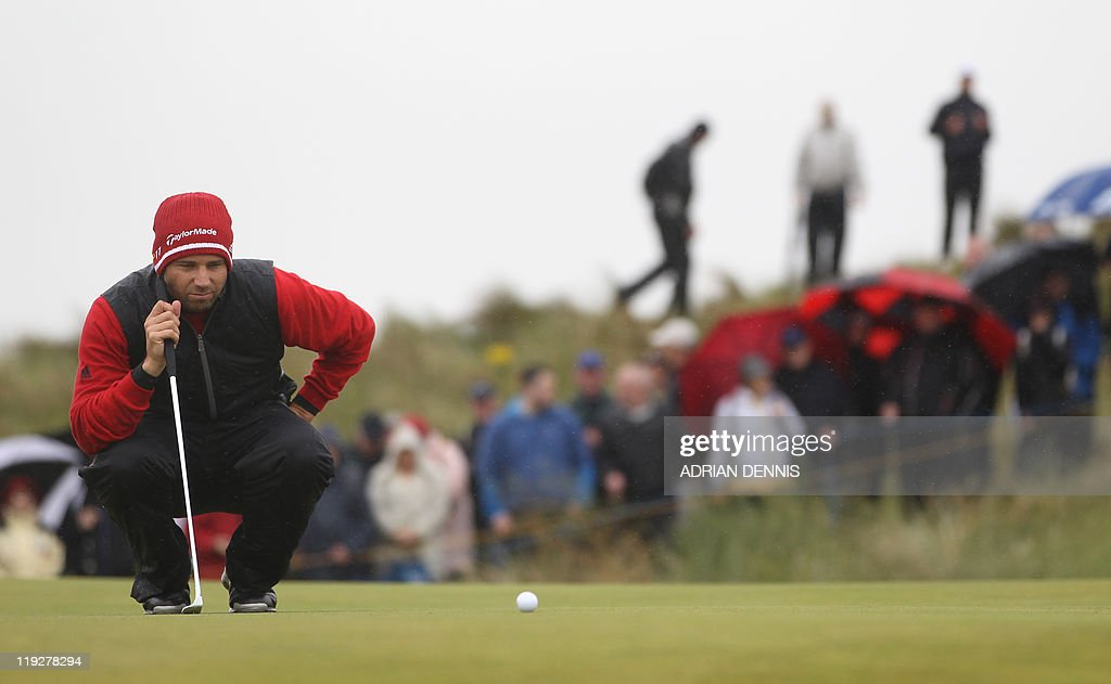 Spanish golfer Sergio Garcia lines up his putt on the 1st green on the third day of the 140th British Open Golf championship at Royal St George's in Sandwich, Kent, south east England, on July 16, 2011.