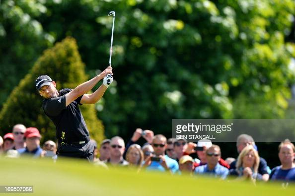 Spanish golfer Sergio Garcia plays a shot on the 1st hole during the final round of the BMW PGA Championship at Wentworth Golf Club in Surrey England...