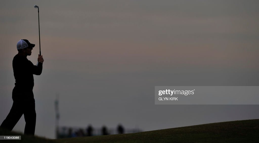 Spanish golfer Sergio Garcia plays a shot on the first day of the 140th British Open Golf championship at Royal St George's in Sandwich, Kent, south east England, on July 14, 2011. AFP PHOTO / GLYN KIRK