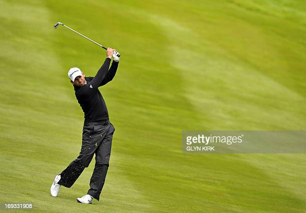 Spanish golfer Sergio Garcia plays his approach shot to the 4th green during the first round of the BMW PGA Championship at Wentworth Golf Club in...