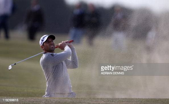 Spanish golfer Sergio Garcia plays out of a bunker on the 15th hole on the second day of the 140th British Open Golf championship at Royal St...
