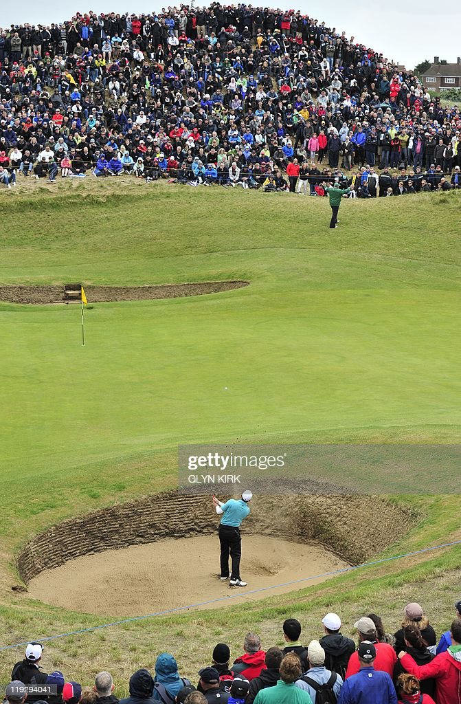 Spanish golfer Sergio Garcia plays out of a bunker onto the 6th green on the final day of the 140th British Open Golf championship at Royal St George's in Sandwich, Kent, south east England, on July 17, 2011.