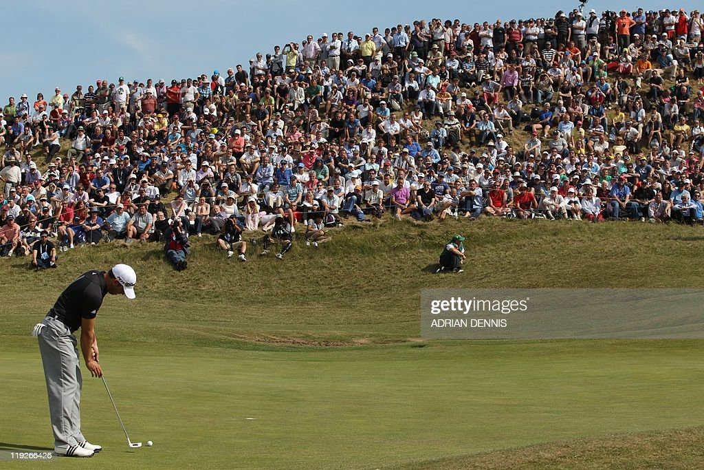 Spanish golfer Sergio Garcia putts on 6th green on the second day of the 140th British Open Golf championship at Royal St George's in Sandwich, Kent, south east England, on July 15, 2011.