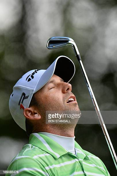Spanish golfer Sergio Garcia reacts after his tee shot on the 2nd hole during the third round of the BMW PGA Championship at Wentworth Golf Club in...