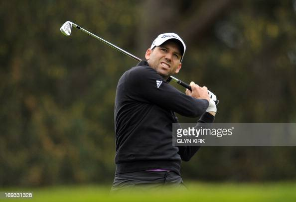 Spanish golfer Sergio Garcia reacts as he watches his drive from the 8th tee during the first round of the BMW PGA Championship at Wentworth Golf...