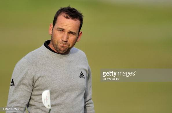 Spanish golfer Sergio Garcia reacts on the 18th green after finishing his second round on the second day of the 140th British Open Golf championship...