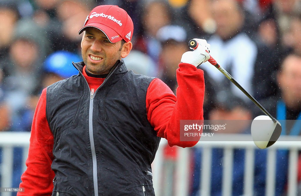 Spanish golfer Sergio Garcia reacts on the 1st Tee on the third day of the 140th British Open Golf championship at Royal St George's in Sandwich, Kent, south east England, on July 16, 2011.