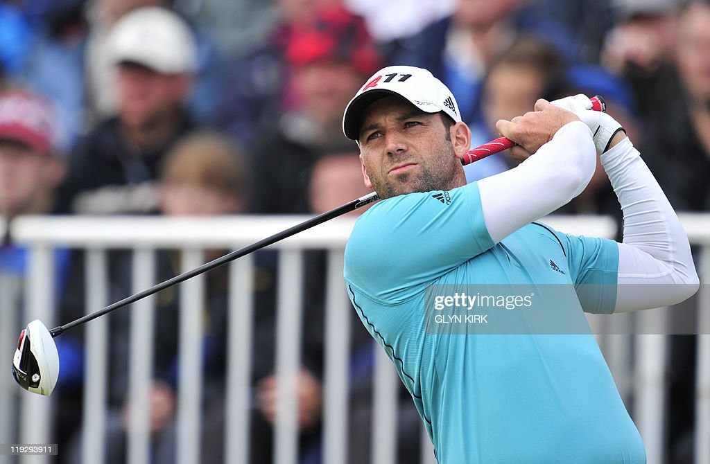 Spanish golfer Sergio Garcia watches his drive from the 1st Tee, on the final day of the 140th British Open Golf championship at Royal St George's in Sandwich, Kent, south east England, on July 17, 2011.