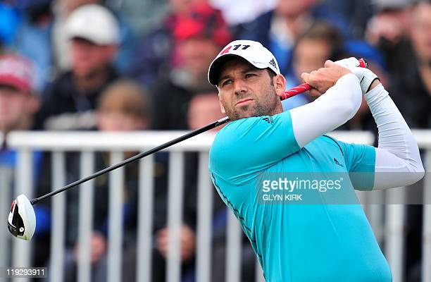 Spanish golfer Sergio Garcia watches his drive from the 1st Tee on the final day of the 140th British Open Golf championship at Royal St George's in...