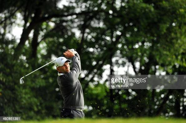Spanish golfer Sergio Garcia watches his drive from the 2nd tee during the first round of the PGA Championship at Wentworth Golf Club in Surrey...