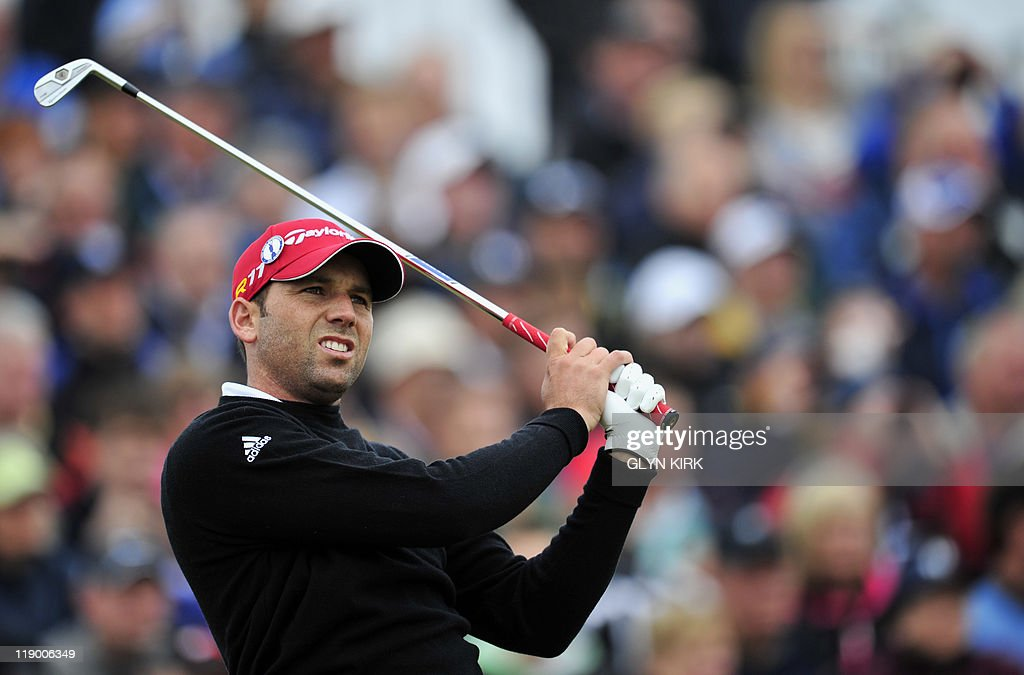 Spanish golfer Sergio Garcia watches his drive from the 3rd Tee on the first day of the 140th British Open Golf championship at Royal St George's in Sandwich, Kent, south east England, on July 14, 2011.