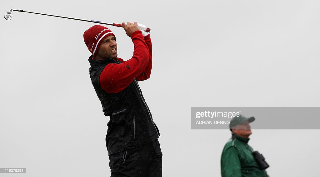 Spanish golfer Sergio Garcia watches his drive from the 3rd Tee on the third day of the 140th British Open Golf championship at Royal St George's in Sandwich, Kent, south east England, on July 16, 2011. AFP PHOTO / ADRIAN DENNIS