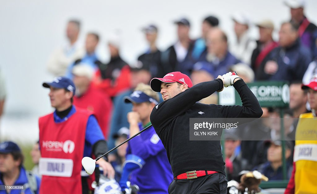 Spanish golfer Sergio Garcia watches his drive from the 4th Tee on the first day of the 140th British Open Golf championship at Royal St George's in Sandwich, Kent, south east England, on July 14, 2011.