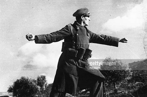 A Spanish government soldier throws a hand grenade towards enemy trenches during the Spanish Civil War