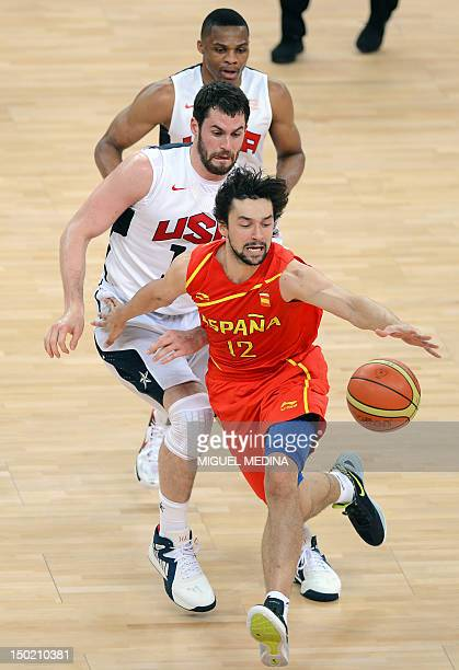 Spanish guard Sergio Llull dribbles past US forward Kevin Love during the London 2012 Olympic Games men's gold medal basketball game between USA and...