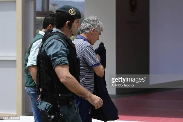 Spanish Guardia Civil escort president of the Spanish Football Federation Angel Maria Villar on arrival to the Spanish football federation...