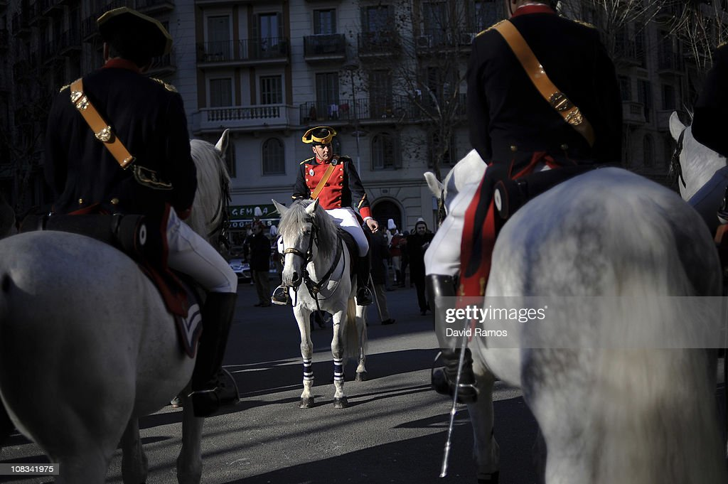 A Spanish Guardia Civil mounted police officer looks on dressed up with a full dress uniform before to start the 'Tres Tombs' or 'Three Tours' parade during the San Anton neighborhood celebrations on January 22, 2011 in Barcelona, Spain. The parade dates back from 1825 and is celebrated in honor of San Anton, the patron saint of animals.