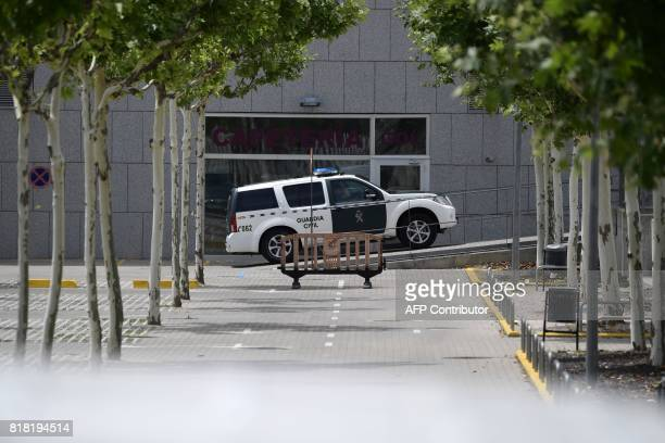 A Spanish Guardia Civil vehicle arrives to the Spanish football federation headquarters in Madrid on July 18 2017 during a raid related to the probe...