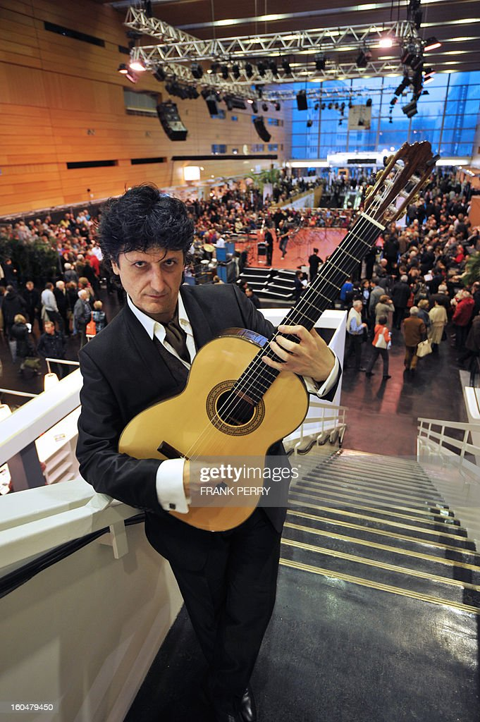 Spanish guitarist Juan Manuel Canizares poses at the Cite des Congres in Nantes during the 'Folle Journee' classic music festival on February 1, 2013. The 19th edition of this festival will run until next February 3. AFP PHOTO FRANK PERRY