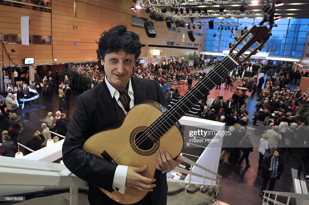 Spanish guitarist Juan Manuel Canizares poses at the Cite des Congres in Nantes during the 'Folle Journee' classic music festival on February 1, 2013. The 19th edition of this festival will run until next February 3.