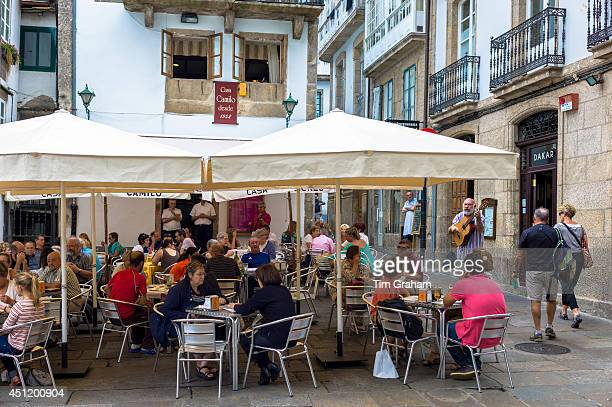 Spanish guitarist serenading diners at Casa Camilo bar restaurant in Santiago de Compostela Galicia Spain