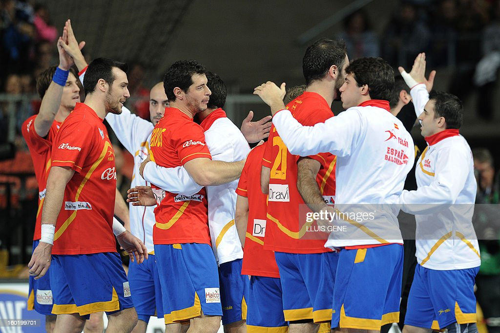 Spanish handball players celebrate a coal during the 23rd Men's Handball World Championships final match Spain vs Denmark at the Palau Sant Jordi in Barcelona on January 27, 2013.