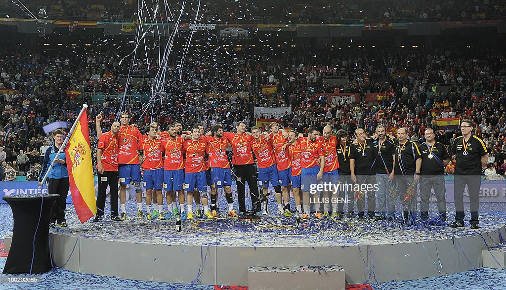 Spanish handball players celebrate their victory as they pose on the podium at the end of the 23rd Men's Handball World Championships final match Spain vs Denmark at the Palau Sant Jordi in Barcelona on January 27, 2013. Spain won 35-19.