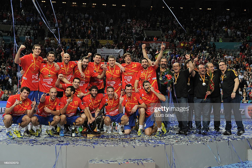Spanish handball players celebrate their victory on the podium at the end of the 23rd Men's Handball World Championships final match Spain vs Denmark at the Palau Sant Jordi in Barcelona on January 27, 2013. Spain won 35-19.