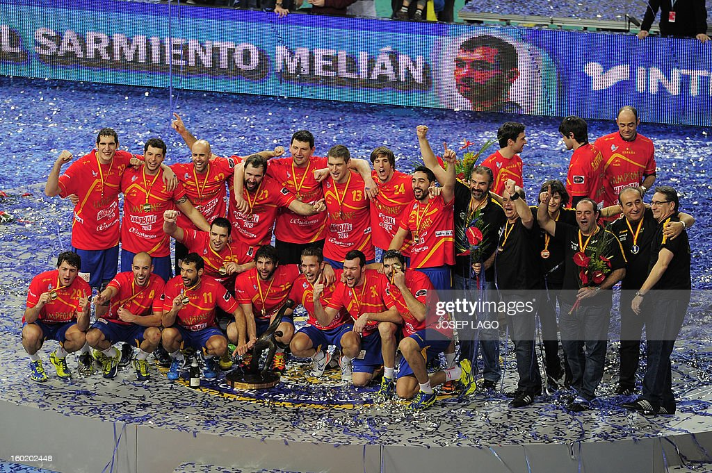 Spanish handball team celebrate their victory on the podium at the end of the 23rd Men's Handball World Championships final match Spain vs Denmark at the Palau Sant Jordi in Barcelona on January 27, 2013. Spain won 35-19.